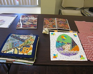 Neighbors | Natalie Wright.Quilting patterns and books were on display at the back of the meeting room at the Boardman library on July 20.