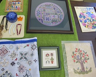 Neighbors | Natalie Wright.Some of the intricate past projects from members of the Youngstown Embroidery Guild were on display for inspiration at the Boardman library on July 20.