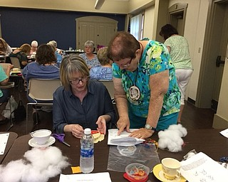 Neighbors | Submitted.A volunteer from the Youngstown Embroidery Guild went over the instructions for the July 20 project at the Boardman library's Crazy Quilting event.