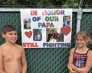 Neighbors | Submitted.Canfield Swim Club swim team members Anthony and Ava Mazzella honored their grandfather during the team's annual Swim-A-Thon, which raised money for the Showers Family Center For Childhood Cancer at Akron Children's Hospital in Boardman, on July 19.