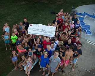 Neighbors | Submitted.The Canfield Swim Club swim team had its seventh annual Swim-A-Thon on July 19. All donations raised by the team members were donated locally to the Showers Family Center For Childhood Cancer at Akron Children's Hospital in Boardman.