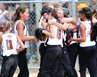 Canfield celebrates after winning the 10U softball state championship game against Tallmadge at Indian Hills Field on Thursday.