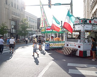 People walk around the Greater Youngstown Italian Fest on Friday. EMILY MATTHEWS | THE VINDICATOR