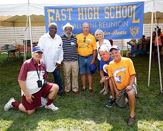 From left, Frank Polofka, Al Jackson, Ed McElroy, Nick DePinto, Margi Napoli, A.J. Napoli, and Joe LoCicero, all of East High School's class of 1960, pose for a photo at the East High School Almuni Reunion on Saturday.