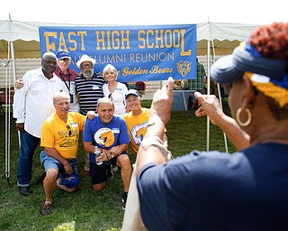 Sally Hawkins, East High School class of 1962 and a member of the alumni committee, takes a photo of alumni of the class of 1960 from left, back to front, Al Jackson, Frank Polofka, Ed McElroy, Margi Napoli, Nick DePinto, A.J. Napoli, and Joe LoCicero at the East High School Almuni Reunion on Saturday.