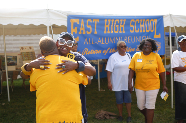 Lynnette Miller, who graduated in 1969 and taught history, hugs Latanya Foster, class of 1992, at the East High School Alumni Reunion on Saturday. Foster said Miller was her African American history teacher in 1992.