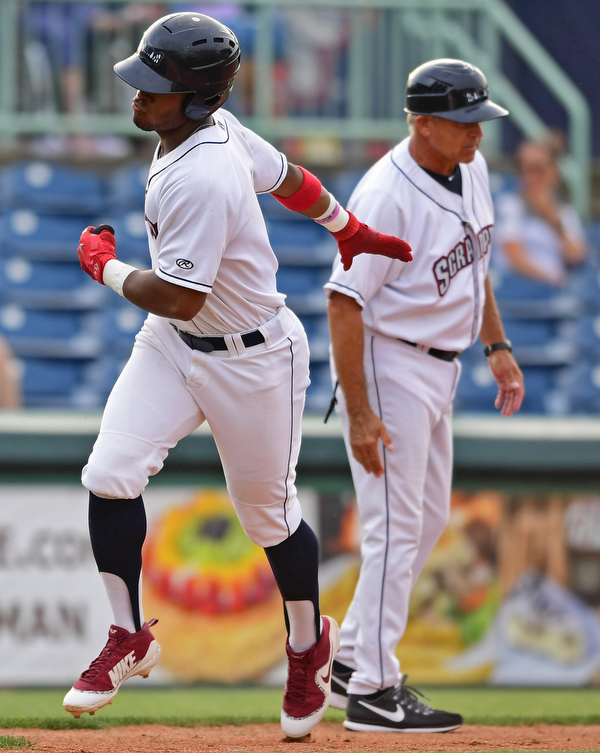 NILES, OHIO - AUGUST 6, 2018: Mahoning Valley Scrappers' Hosea Nelson is congratulated by manger Jim Pankovits after hitting a solo home run off State College Spikes starting pitcher Franyel Casadilla in the second inning of a baseball game, Monday night at Eastwood Field in Niles. DAVID DERMER | THE VINDICATOR