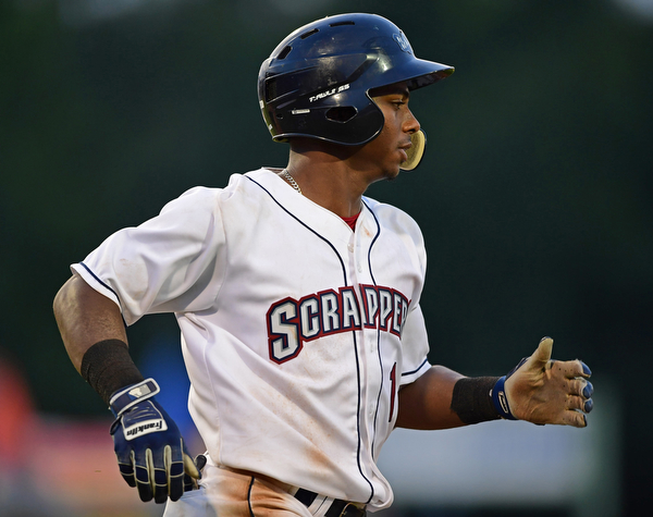 NILES, OHIO - AUGUST 6, 2018: Mahoning Valley Scrappers' Ronny Dominguez singles in the fifth inning of a baseball game against the State College Spikes, Monday night at Eastwood Field in Niles. DAVID DERMER   THE VINDICATOR