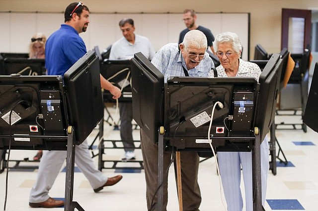Voters are at the polls where President Donald Trump's preferred congressional candidate — and his chief legislative achievement — are about to be tested in battleground Ohio in the season's final high-stakes special election.
