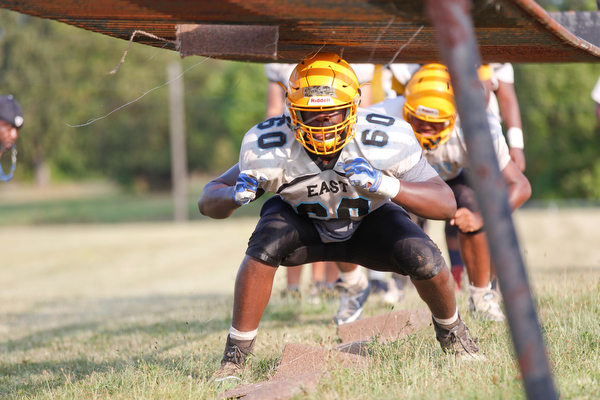 Terrance Teboah does linemen drills at East High School's football practice Tuesday evening.