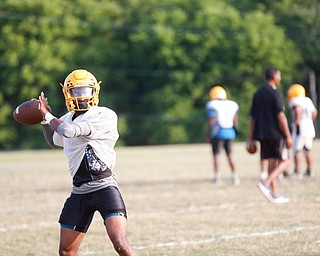 Zane Cylar prepares to throw the ball at East High School's football practice Tuesday evening.