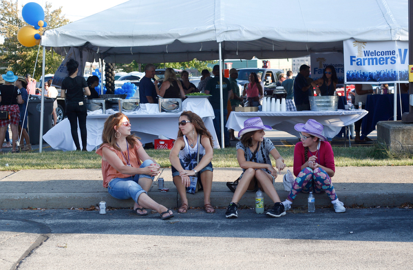 From left, Jennifer Fentress, Ashley Mansour, Sydney Mansour, 12, and Samantha Frohman, 12, all of Hubbard, sit in the tailgating parking lot before the Florida Georgia Line Concert on Saturday. EMILY MATTHEWS | THE VINDICATOR
