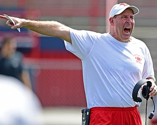 AUSTINTOWN, OHIO - AUGUST 11, 2018: Youngstown State head coach Bo Pelini shouts instructions during the teams practice, Saturday morning at Austintown Fitch High School. He would score on the play. DAVID DERMER | THE VINDICATOR