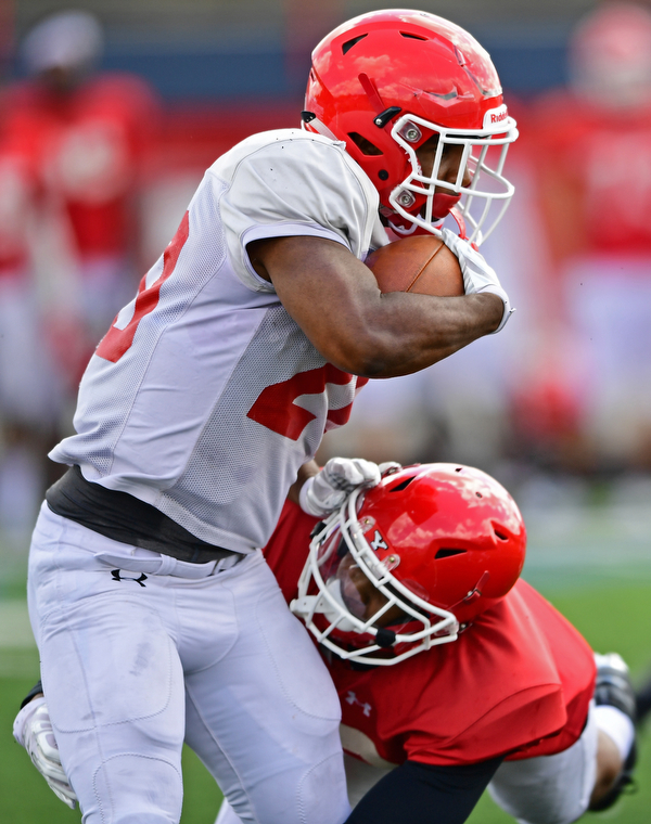 AUSTINTOWN, OHIO - AUGUST 11, 2018: Youngstown State's Christian Turner is wrapped up by Design Taylor during the teams practice, Saturday morning at Austintown Fitch High School. He would score on the play. DAVID DERMER | THE VINDICATOR