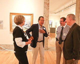 ROBERT K.YOSAY  | THE VINDICATOR..World renown cellist Yo-Yo Ma, and Deborah Rutter, director of the Kennedy Center for Performing Arts arrived at the Butler Institute of American Art this afternoon for a private lunch and discussion on the arts.. With them is Bill Mullane Fine Arts Council of Trumbull County and Lou Zona..-30-