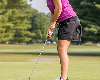 DIANNA OATRIDGE | THE VINDICATOR Felicia Ciotola-Drevna sinks her putt for birdie on Hole No. 2 during the Ladies 2-player Championship of the Greatest Golfer of the Valley held at Trumbull Country Club in Warren on Wednesday.