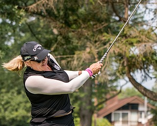 DIANNA OATRIDGE | THE VINDICATOR Kim Staton takes her second shot during the Ladies 2-player Championship of the Greatest Golfer of the Valley held at Trumbull Country Club in Warren on Wednesday.