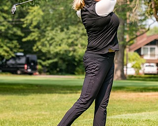 DIANNA OATRIDGE | THE VINDICATOR Kim Staton watches her second shot during the Ladies 2-player Championship of the Greatest Golfer of the Valley held at Trumbull Country Club in Warren on Wednesday.