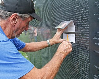 ROBERT K.YOSAY  | THE VINDICATOR..The Healing Wall - dedication - at  Packard Park..Tim Ryan ..Doing a rubbing  Chuck Jaros as a remembering of his uncle..-30-