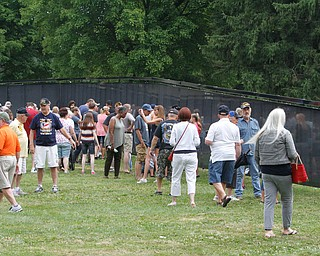 ROBERT K.YOSAY  | THE VINDICATOR..The Healing Wall - dedication - at  Packard Park..Tim Ryan . Crowds... visit the wall ..-30-