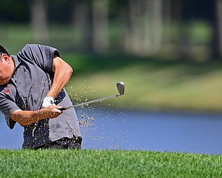HOWLAND, OHIO - AUGUST 18, 2018: Andrew Smyczynski of Canfield watches his shot from the bunker on the ninth hole, Saturday afternoon during the Vindy Greatest Golfer at Avalon Lakes. DAVID DERMER | THE VINDICATOR
