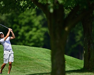 HOWLAND, OHIO - AUGUST 18, 2018: Mike McClure of Struthers watches his approach shot on the ninth hole, Saturday afternoon during the Vindy Greatest Golfer at Avalon Lakes. DAVID DERMER | THE VINDICATOR