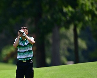 HOWLAND, OHIO - AUGUST 18, 2018: Dan Diloreto of Struthers uses a range finder on the 12th hole, Saturday afternoon during the Vindy Greatest Golfer at Avalon Lakes. DAVID DERMER | THE VINDICATOR