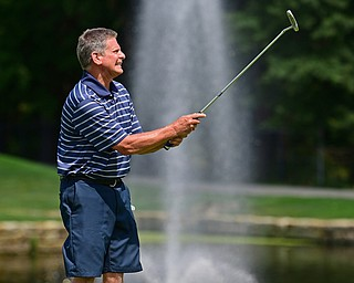 HOWLAND, OHIO - AUGUST 18, 2018: Bob Tinney of Poland reacts after missing a putt on the ninth hole, Saturday afternoon during the Vindy Greatest Golfer at Avalon Lakes. DAVID DERMER | THE VINDICATOR