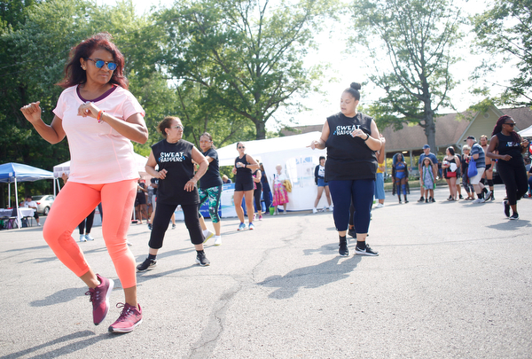 Aida Quinn, front left, of Hubbard and originally from Panama City, does Zumba with others at the Latino Heritage Festival in Campbell on Saturday. EMILY MATTHEWS | THE VINDICATOR