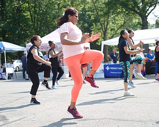 Aida Quinn, front center, of Hubbard and originally from Panama City, does Zumba with others at the Latino Heritage Festival in Campbell on Saturday. EMILY MATTHEWS | THE VINDICATOR