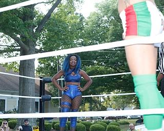Wrestler Joseline Navarro looks at her opponent Mambo Italiano at the Latino Heritage Festival in Campbell on Saturday. EMILY MATTHEWS | THE VINDICATOR