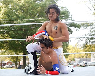 Wrestler Cree Fudo, above, tries to take down his opponent Marc-Anthony Alejandro at the Latino Heritage Festival in Campbell on Saturday. EMILY MATTHEWS | THE VINDICATOR