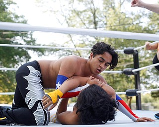 Wrestler Marc-Anthony Alejandro tries to pin down his opponent Cree Fudo at the Latino Heritage Festival in Campbell on Saturday. EMILY MATTHEWS | THE VINDICATOR