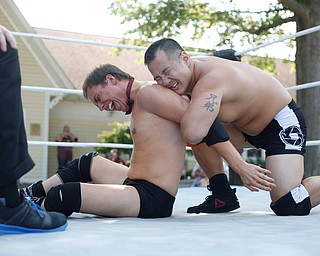 Calvin Couture, left, and Dan Hooven wrestle at the Latino Heritage Festival in Campbell on Saturday. EMILY MATTHEWS | THE VINDICATOR