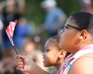 Jodairys Vasquez, 9, of Campbell, waves a Puerto Rican flag while watching wrestling at the Latino Heritage Festival in Campbell on Saturday. EMILY MATTHEWS | THE VINDICATOR