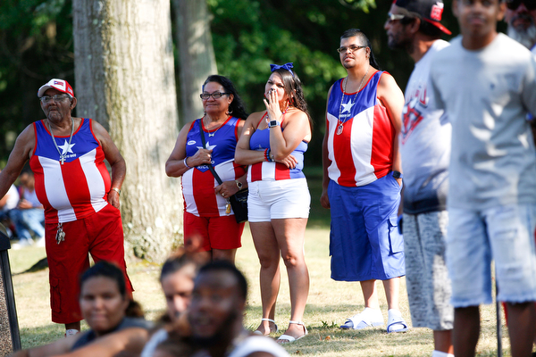 From left, Francisco Laviena, Juana Silva, Alexandra Laviena, and Carmelo Cintron, all of Youngstown and originally from Puerto Rico, watch wrestling at the Latino Heritage Festival in Campbell on Saturday. EMILY MATTHEWS | THE VINDICATOR
