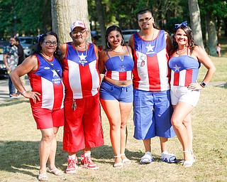 From left, Juana Silva, Francisco Laviena, Aleishka Rodriguez, Carmelo Cintron, and Alexandra Laviena, all of Youngstown and originally from Puerto Rico, pose for a photo at the Latino Heritage Festival in Campbell on Saturday. EMILY MATTHEWS | THE VINDICATOR