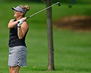 POLAND, OHIO - AUGUST 19, 2018: Angela Molaskey, of Poland, watches her approach shot on the eighth hole during the final round of the Vindy Greatest Golfer, Sunday afternoon at the Lake Club. DAVID DERMER | THE VINDICATOR