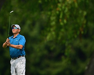 POLAND, OHIO - AUGUST 19, 2018: Shane Heasley, of Canfield, watches his approach shot on the 18th hole during the final round of the Vindy Greatest Golfer, Sunday afternoon at the Lake Club. DAVID DERMER | THE VINDICATOR