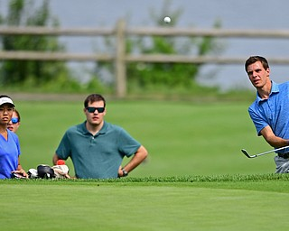 POLAND, OHIO - AUGUST 19, 2018: Ethan Thomas, of Boardman, watches his shot from the short rough on the eighth hole during the final round of the Vindy Greatest Golfer, Sunday afternoon at the Lake Club. DAVID DERMER | THE VINDICATOR