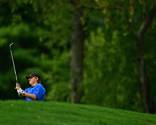 POLAND, OHIO - AUGUST 19, 2018: Paul J. Harris, of Canfield, watches his approach shot on the 18th hole during the final round of the Vindy Greatest Golfer, Sunday afternoon at the Lake Club. DAVID DERMER | THE VINDICATOR