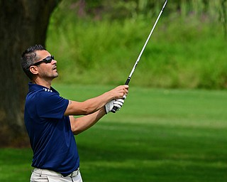 POLAND, OHIO - AUGUST 19, 2018: Brian Newell, of Hubbard, watches his approach on the seventh hole during the final round of the Vindy Greatest Golfer, Sunday afternoon at the Lake Club. DAVID DERMER | THE VINDICATOR