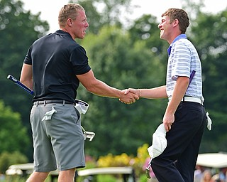 POLAND, OHIO - AUGUST 19, 2018: Scotty Jones, left, shakes hands with Joey Cilone after the completion of their round, Sunday afternoon at the Lake Club. DAVID DERMER | THE VINDICATOR