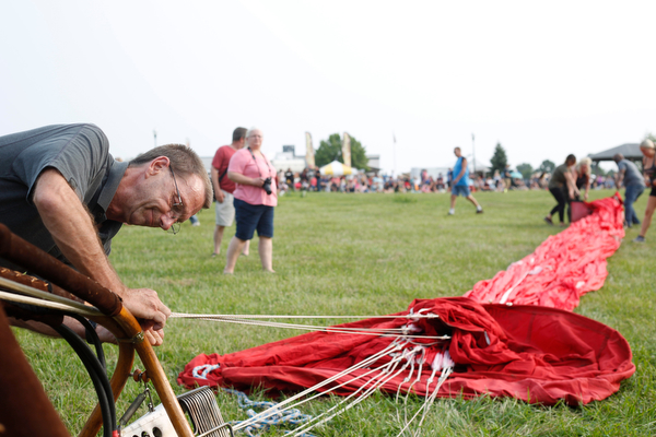 Allan Caddell, of Akron, gets a hot balloon ready at the Hot air balloon festival at Mastropietro Winery on Sunday..