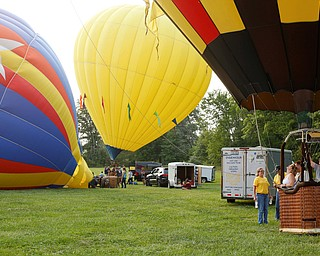 People get ready to take off while other balloons are inflated at the Hot air balloon festival at Mastropietro Winery on Sunday..