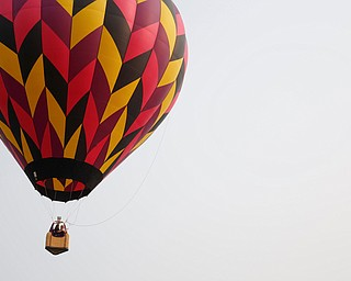 A hot air balloon floats in the air at the Hot air balloon festival at Mastropietro Winery on Sunday.