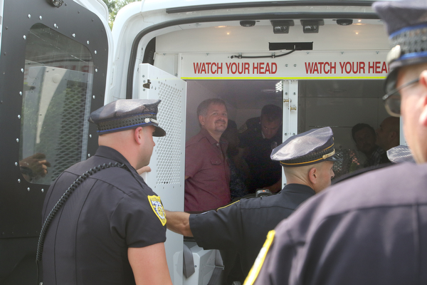 ROBERT K.YOSAY  | THE VINDICATOR..In the spirit of the afternoon, Akron-Canton area residents John Beaty, Austin Miller, Dustin White, James Talbert and JR Rozco prepared for their arrest with a song...After three hours of protest chants, the five clergy members stood at the entrance of the Northeast Ohio Correctional Center on Youngstown-Hubbard Road on Monday with their arms around each other and sang ÒNearer, My God, To TheeÓ Ð the hymn associated with the sinking of the Titanic....-30-
