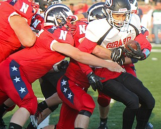 William D. Leiws The Vindicator  Girard's Morgan Clardy (2) is stopped by a host of Niles defenders during the Aug. 23 game at Niles.