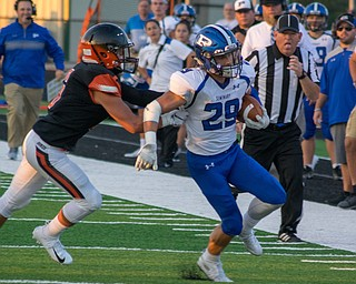 Poland receiver Mitchell Frederick is pushed out of bounds by Marlington defender Ryan Cooley in the Bulldogs' 17-14 victory Thursday night in Alliance...BOB ETTINGER | THE VINDICATOR...