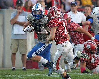 Adam Gatrell (31) of Western Reserve puts out an arm to prevent the tackle by Columbiana's Brandt Virden (1) during Thursday night's matchup at Firestone Park in Columbiana. Dustin Livesay  |  The Vindicator  8/23/18  Columbiana